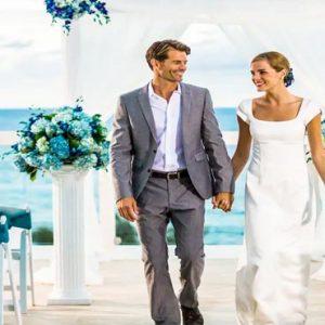 Beach Weddings Abroad Jamaica Weddings Couple Walking Down Aisle