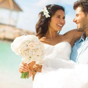 Beach Weddings Abroad Jamaica Weddings Groom Carrying Bride On Beach